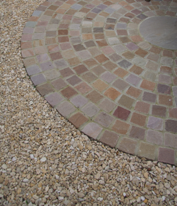 Gravel next to seating area laid with sandstone setts