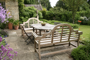 Classic garden furniture on the terrace creates a comfortable outdoor dining area
