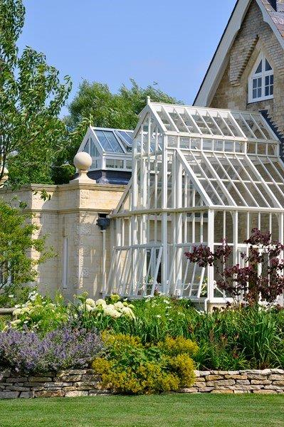 A bespoke double height greenhouse attached to the house