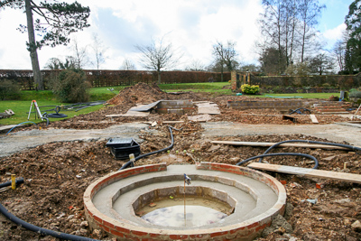 A new circular pool sits where the old swimming pool was, with a rill leading back to a raised pool