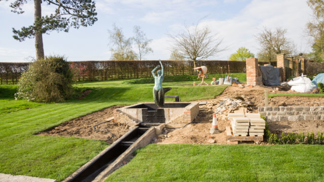 LANDSCAPING client's sculpture in place