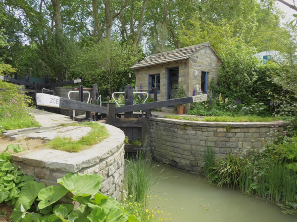 The Welcome to Yorkshire Garden with canal and lock keeper's cottage.